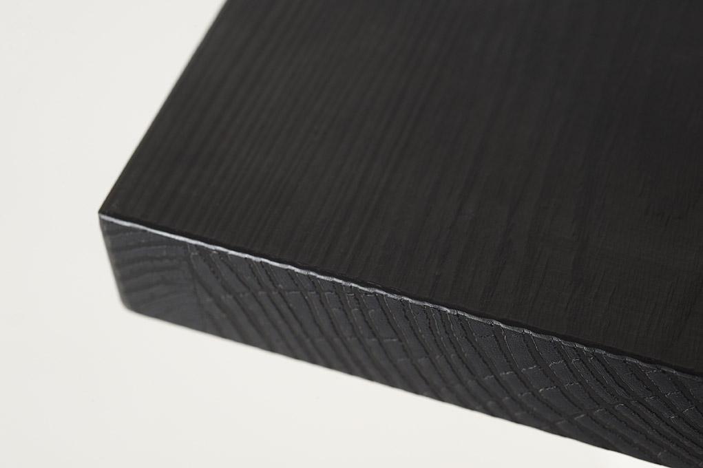 canto madera maciza negro
